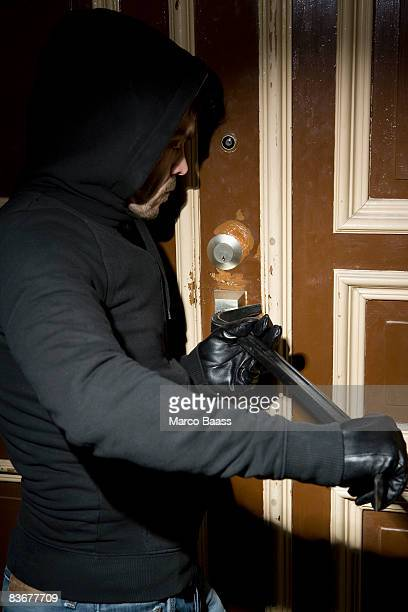 A man burglarizing a home