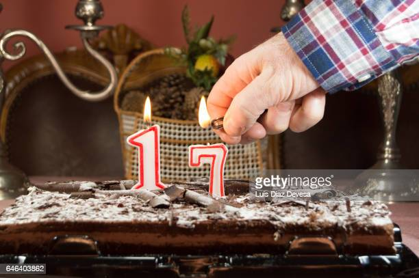 man burning candles with a lighter - parte de stock pictures, royalty-free photos & images