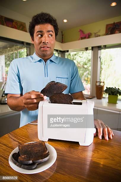 Man burning toast