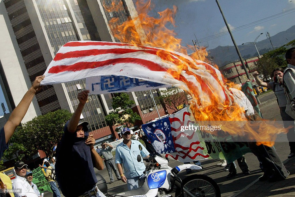 A man burns a US flag during a protest against the visit of US Secretary of State Condoleezza Rice 23 January 2008 in Medellin, Antioquia department, Colombia. Rice will arrive in Colombia on Thursday for a 24-hour official visit. AFP PHOTO/Raul ARBOLEDA