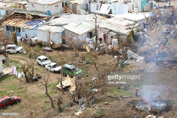 A man burns fallen strees in Cay Bay Saint Maarten days after this Caribbean island sustained extensive damage after the passing of Hurricane Irma on...