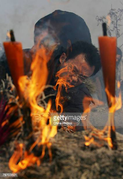A man burns incense to worship the God of Wealth at the Guiyuan Temple on February 11 2008 in Wuhan of Hubei Province China Chinese people have the...