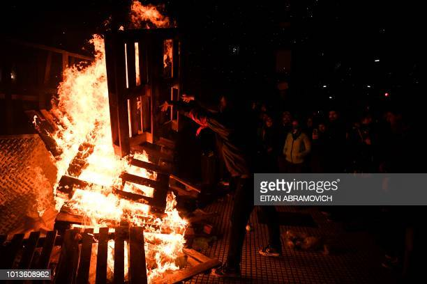 A man burns wood outside the National Congress in Buenos Aires on August 9 after senators rejected the bill to legalize abortion Argentine senators...