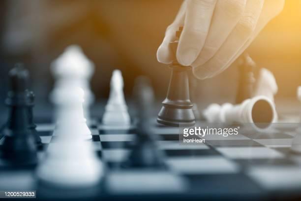 man business concept controling chess, - pedone ruolo dell'uomo foto e immagini stock