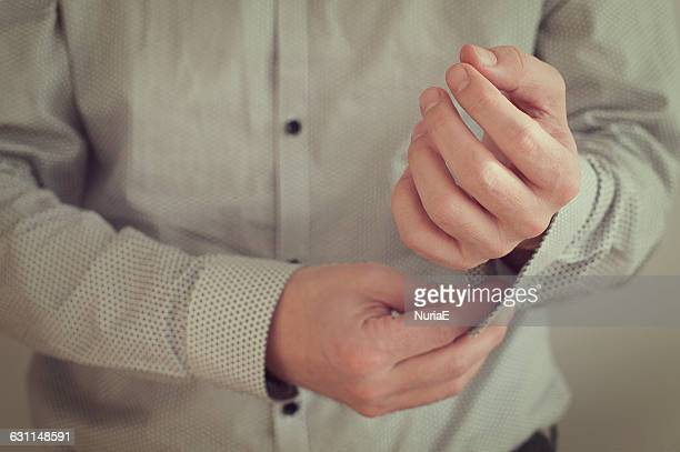 man buttoning shirt - unbuttoned shirt stock photos and pictures