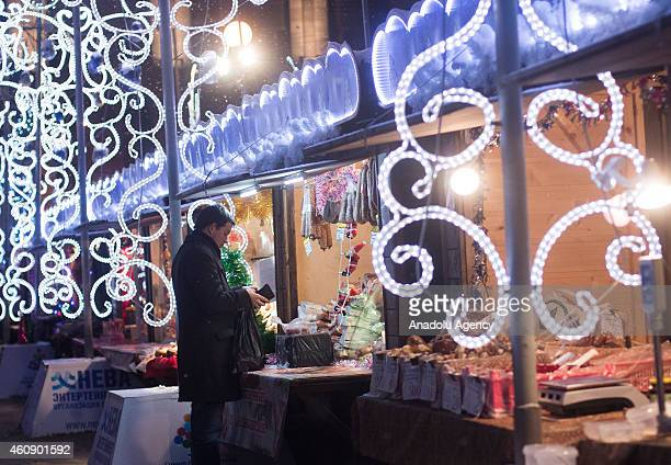 A man buy Christmas gift during Christmas fair in SaintPetersburg Russia on December 282014
