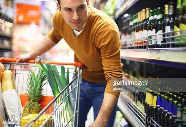 Man buying beer in supermarket.