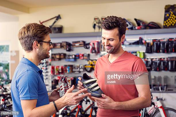 man buying cycling shoes - serving sport stock pictures, royalty-free photos & images