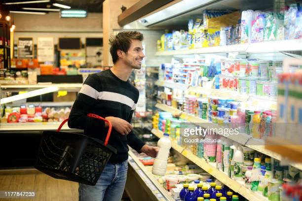 man buying dairy products - convenience store stock pictures, royalty-free photos & images