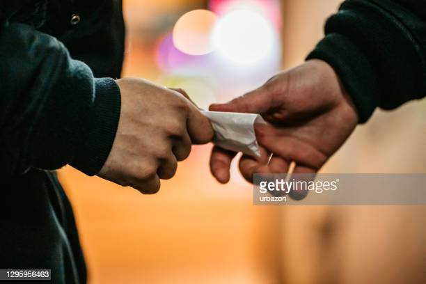 man buying drugs on the street - drug dealer stock pictures, royalty-free photos & images