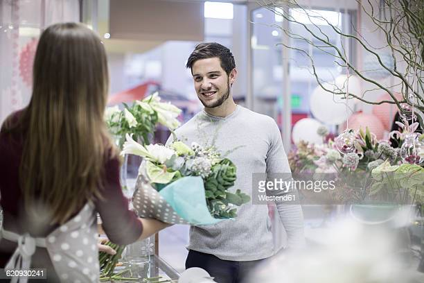 Man buying flowers in flower shop
