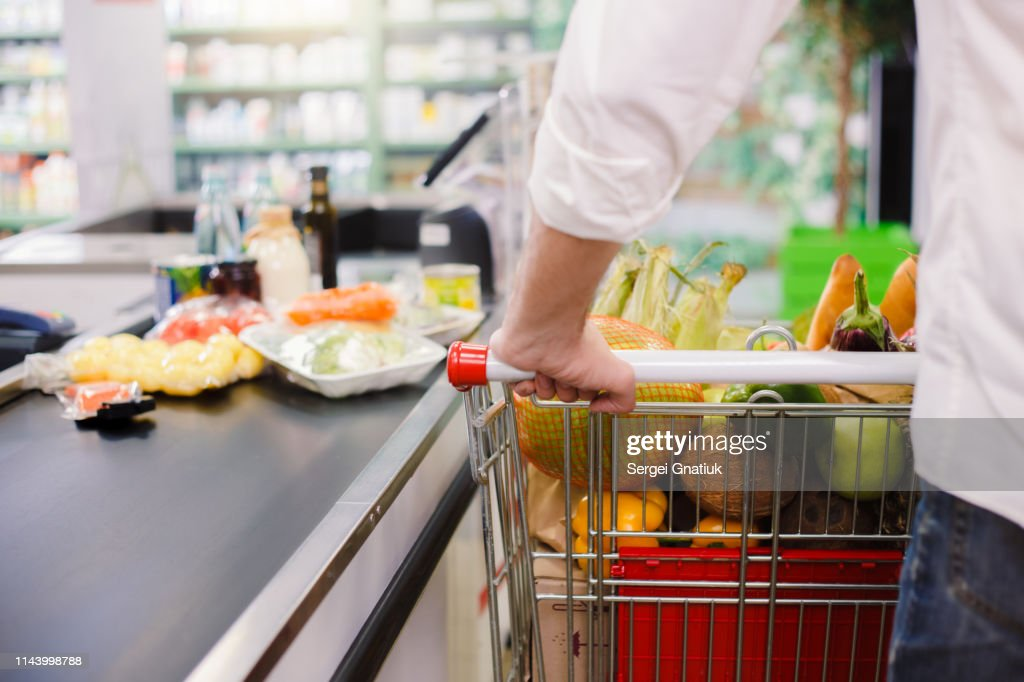Man buying food products in the supermarket shopping : Stock Photo