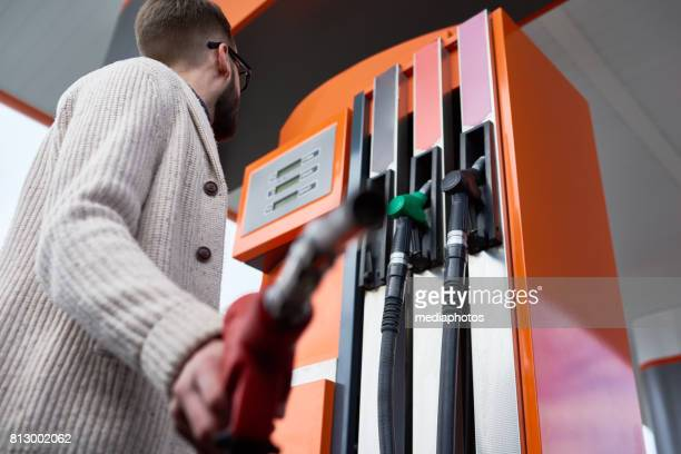 Man Buying Fuel in Gas Station