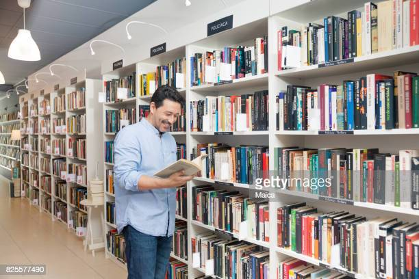 Man buying in a bookstore
