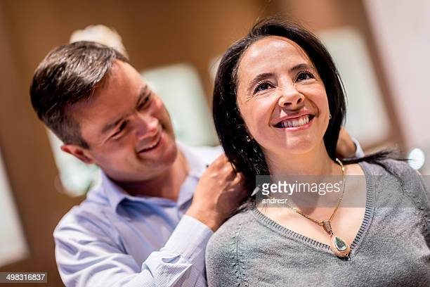 Man buying jewelry for his wife