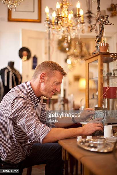 Man buying old items at a flea market