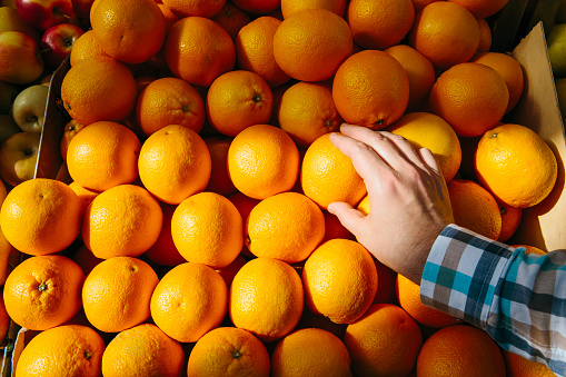 Man buying oranges at the farmer's market, personal perspective point of view - gettyimageskorea