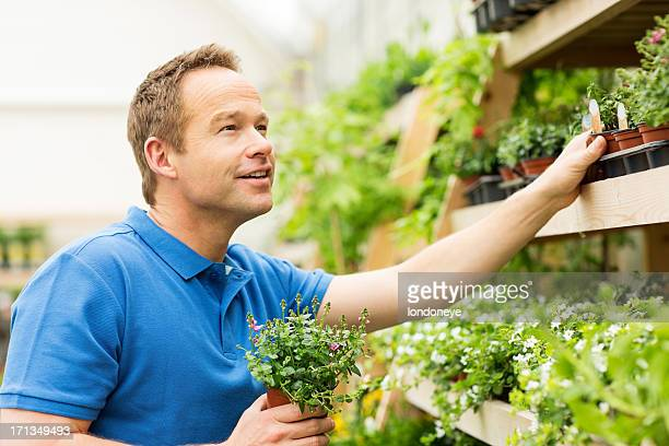 Man Buying Potted Plants At Garden Centre