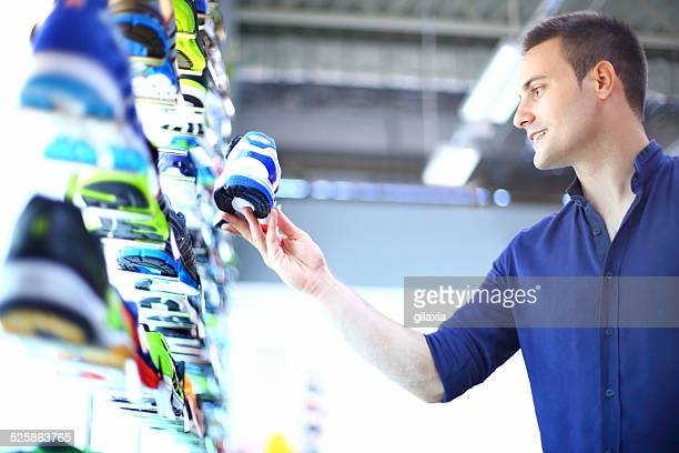 man buying sport shoes. - sports clothing stock pictures, royalty-free photos & images