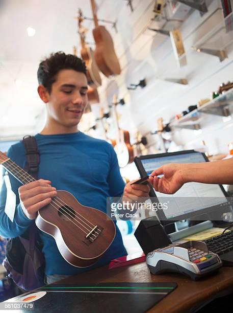 Man buying ukulele