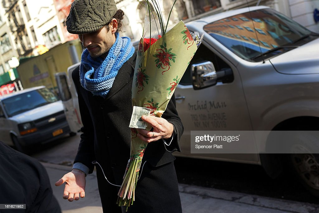 A man buys a bouquet of flowers in the floral district on February 13, 2013 in New York City. With Valentines Day tomorrow, the district is experiencing a rush of floral buyers and sellers to service customers on the national day of romance. Along with Mother's Day, Valentine's Day is one of the busiest days of the year for florists and flower growers.