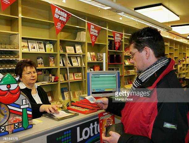 A man buys a lottery ticket at a newsagent's store on November 29 2007 in Pinneberg near Hamburg Germany The jackpot of the German lottery has risen...