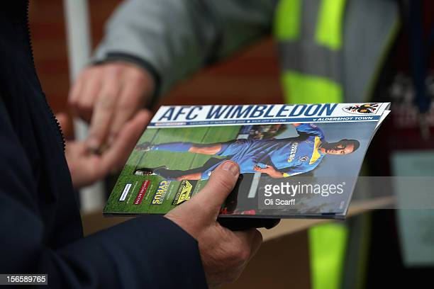A man buys a match programme outside AFC Wimbledon's stadium before the npower League Two match between AFC Wimbledon and Aldershot Town at the...