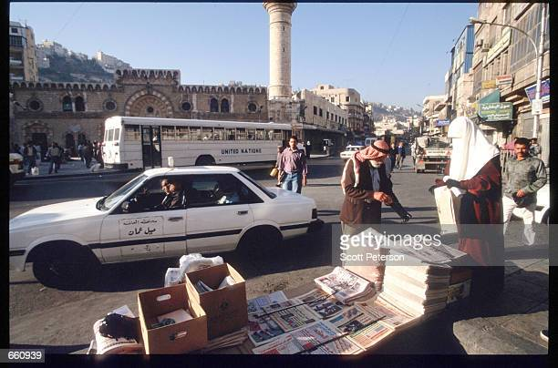 A man buys a newspaper from a vendor May 17 1998 in Amman Jordan Still a teenager when crowned in 1952 King Hussein has led the young Arab nation...