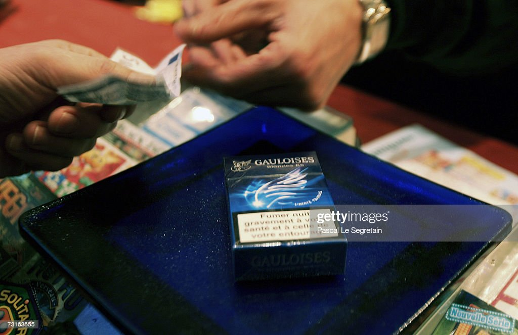 A man buys a pack of cigarettes on January 31, 2007 in Paris, France. France will introduce a smoking ban in public places February 1, 2007 and bars, restaurants, hotels and night clubs will follow on January 1, 2008.