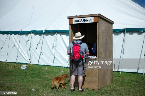 A man buys a programme from a kiosk during 152nd the Ryedale Country Show on July 31 2018 in Kirbymoorside England Held in Welburn Park near...