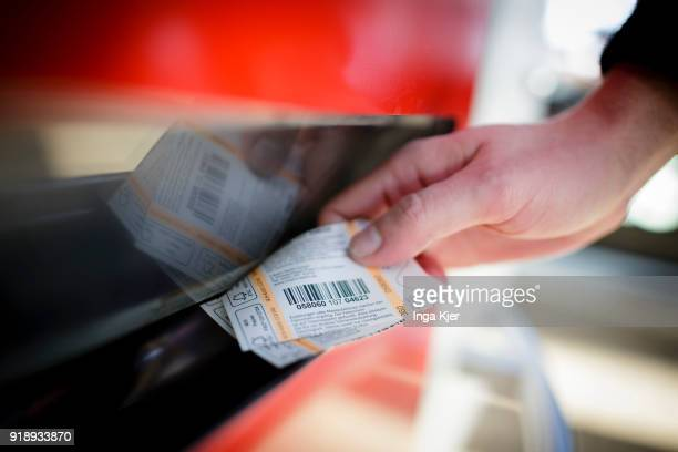 A man buys a ticket at a ticktet machine on February 14 2018 in Berlin Germany