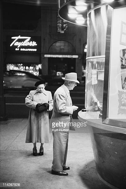 A man buys a ticket to a film at the Egyptian Theatre on Hollywood Boulevard Los Angeles 1951 Original Publication Picture Post 5298 Two Men In...