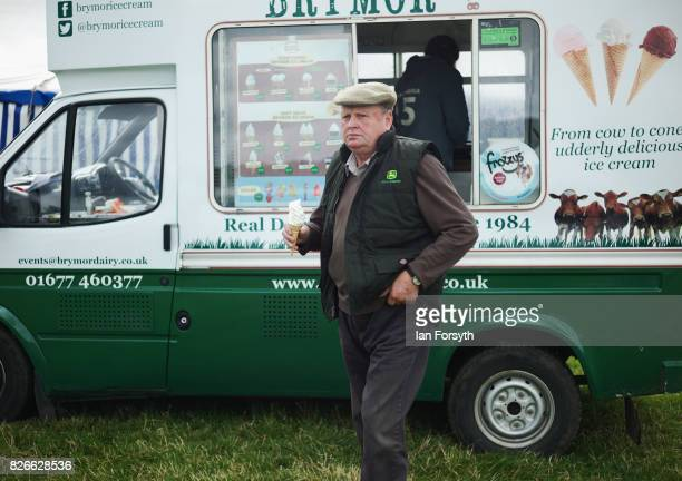 Man buys an ice cream during the Osmotherley Country Show on August 5, 2017 in Osmotherley, England. The annual show hosts pony, cattle and sheep...