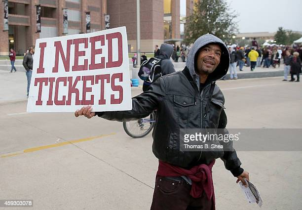 A man buys and sells tickets outside Kyle Field before the Texas AM Aggies played the Missouri Tigers in a NCAA football game on November 15 2014 at...
