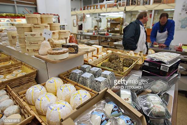A man buys cheese on December 24 2008 at Rungis wholesale food market outside Paris Rungis international market is Europe biggest wholesale food...