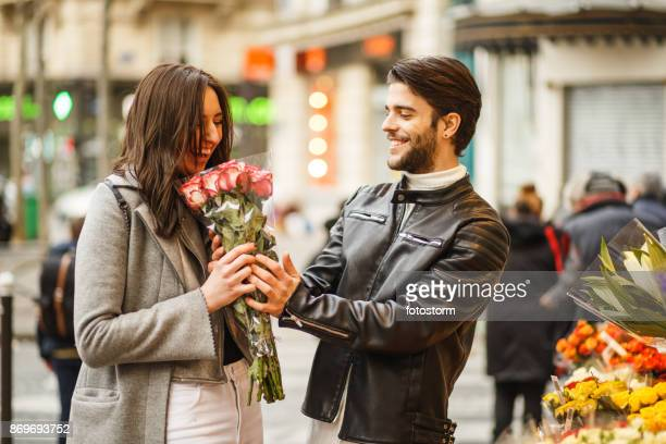 man buys flowers for his dearest - rose colored stock pictures, royalty-free photos & images
