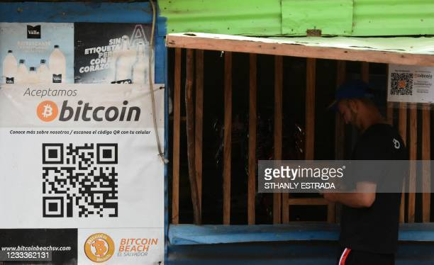 Man buys in a store that accepts bitcoins in El zonte, 56 km south east from San Salvador, on June 09, 2021. - Bitcoin is to become legal tender in...
