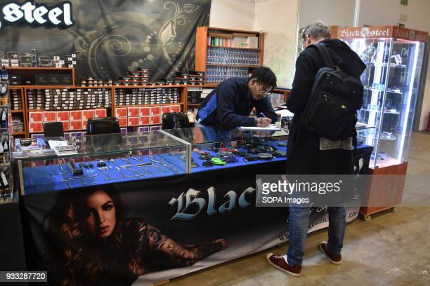 A man buys items for tattooing during the 2nd Spanish tattoo artists Convention of the Only Tattoo Barcelona The Only Tattoo Barcelona 2018 is being...