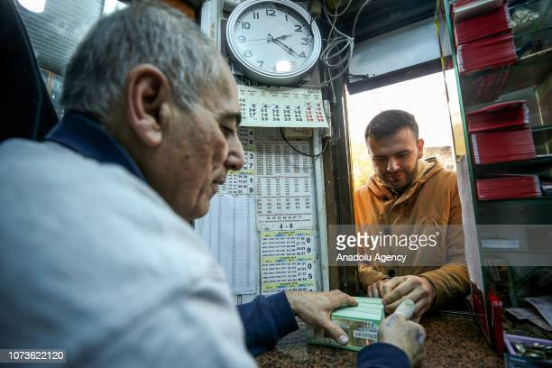 A man buys lottery tickets at Nimet Abla kiosk the most famous ticket agency in Istanbul for Turkey's New Year lottery draw in Eminonu district of...