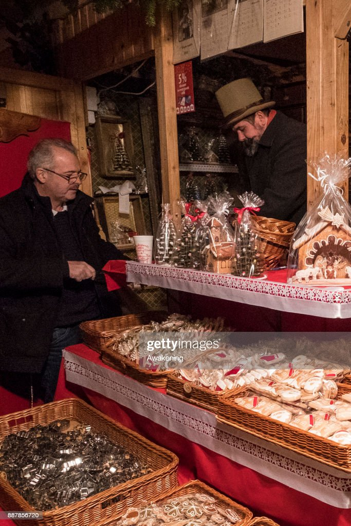 A man buys some traditional Hungarian sweets at the Vorosmarty Square Christmas market on December 7, 2017 in Budapest, Hungary. The traditional Christmas market and lights will stay until 31st December 2017.