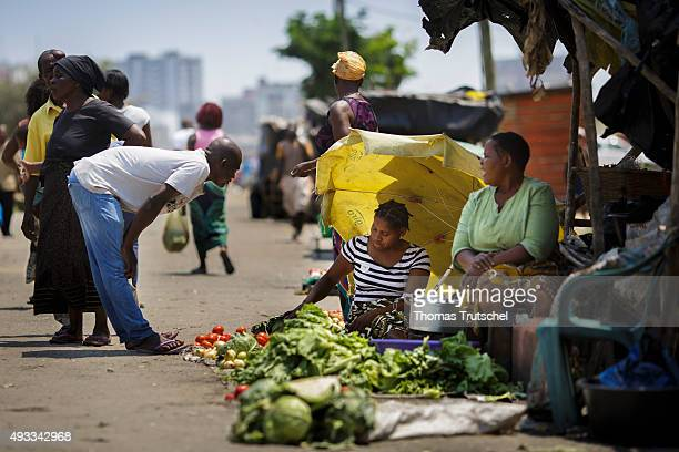 A man buys vegetables at a street market on September 28 2015 in Beira Mozambique