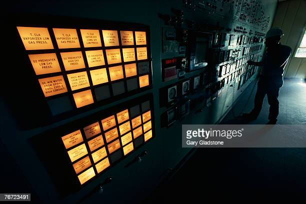 Man by a control panel