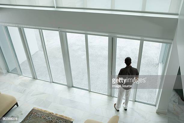 man by patio doors - patio doors stock pictures, royalty-free photos & images