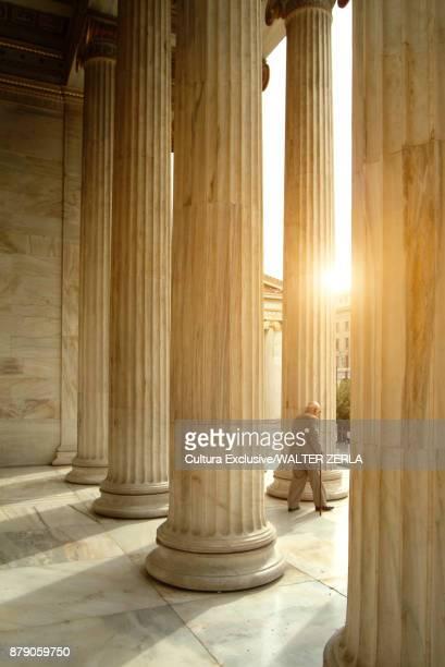 Man by stone pillars, Academy of Athens, Athens, Attiki, Greece, Europe