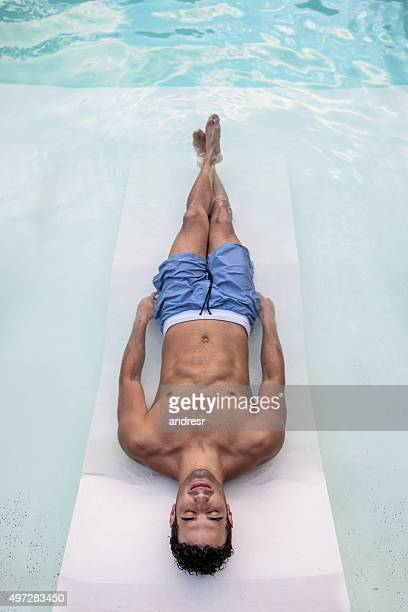 Man by the swimming pool
