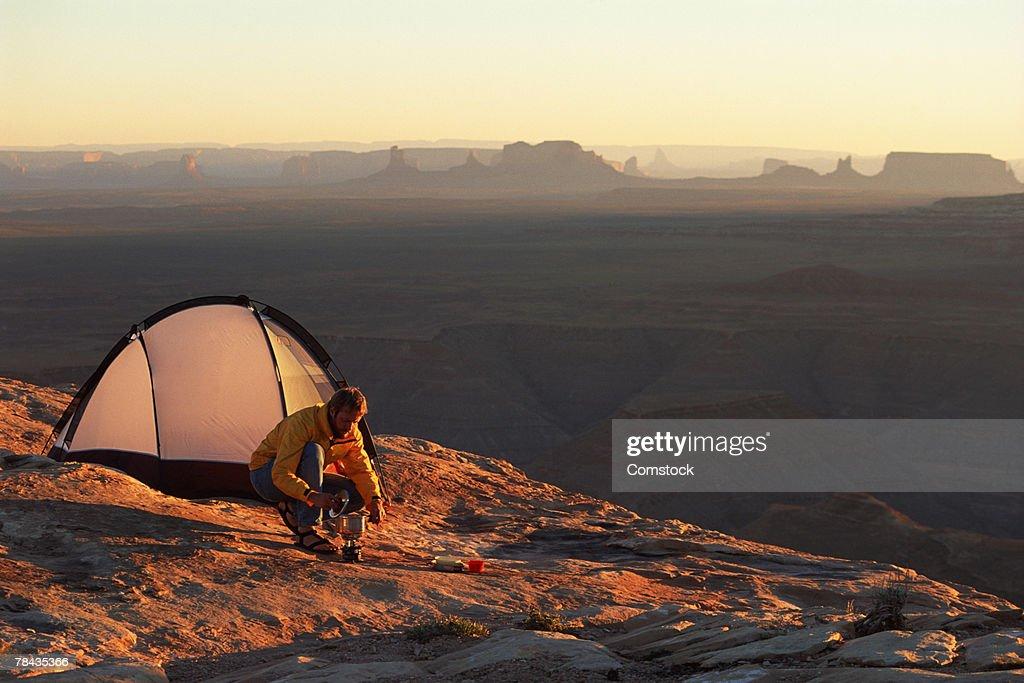 Man camping at Muley Point , Utah : Stockfoto