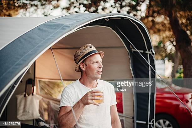 Man camping in his caravan at camping
