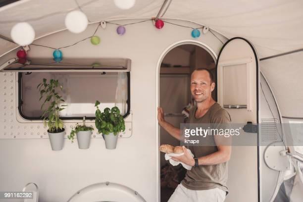 Man camping in his caravan camper in Europe Croatia