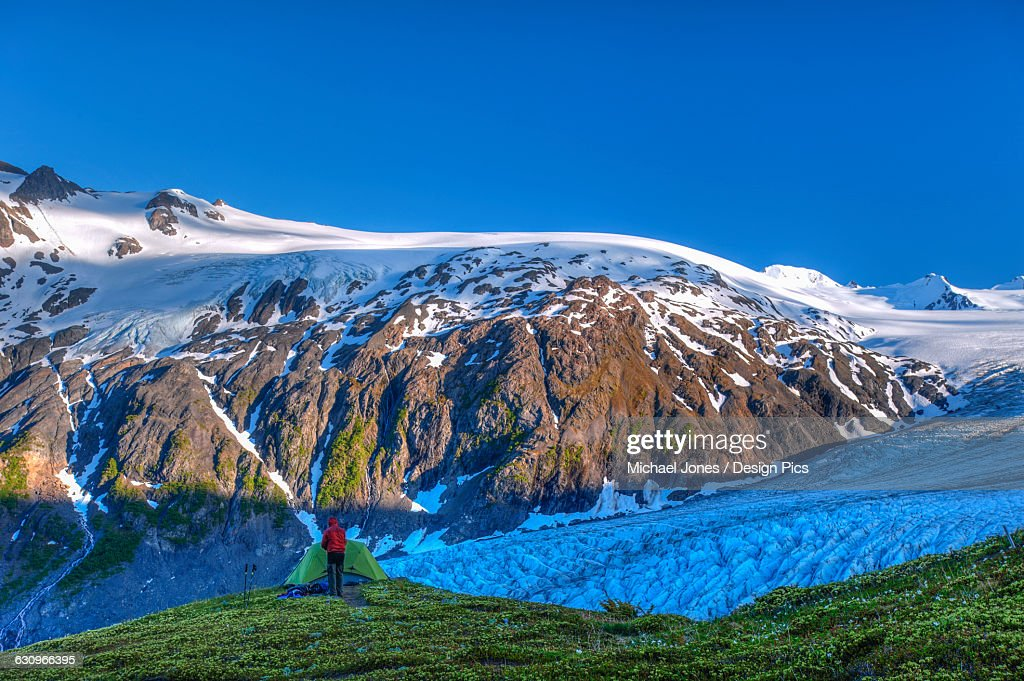 A Man Camping Near Exit Glacier On The Harding Ice Field Trail In