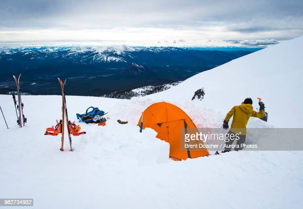 man camping with tent in winter at mt shasta, california, usa - mt shasta stock pictures, royalty-free photos & images